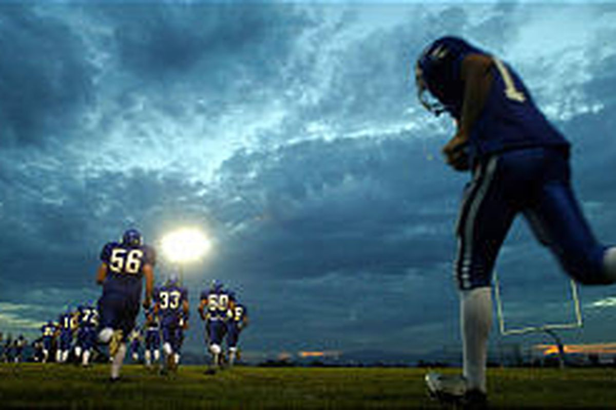 Pleasant Grove High players take to the field in a 2004 game. Prep football is more than games under Friday night lights \\\\— it's a build-up that begins early in the week