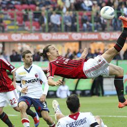 AC Milan forward Zlatan Ibrahimovic, of Sweden, performs an overhead kick during the Serie A soccer match between AC Milan and Bologna at the San Siro stadium in Milan, Italy, Sunday, April 22, 2012.