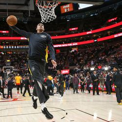 Los Angeles Lakers forward Kyle Kuzma (0) dunks during warmups before the game against the Utah Jazz at Vivint Smart Home Arena in Salt Lake City on Tuesday, April 3, 2018.