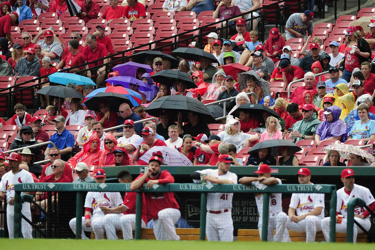 A rain-filled afternoon caused two delays, but the Cardinals won eventually.