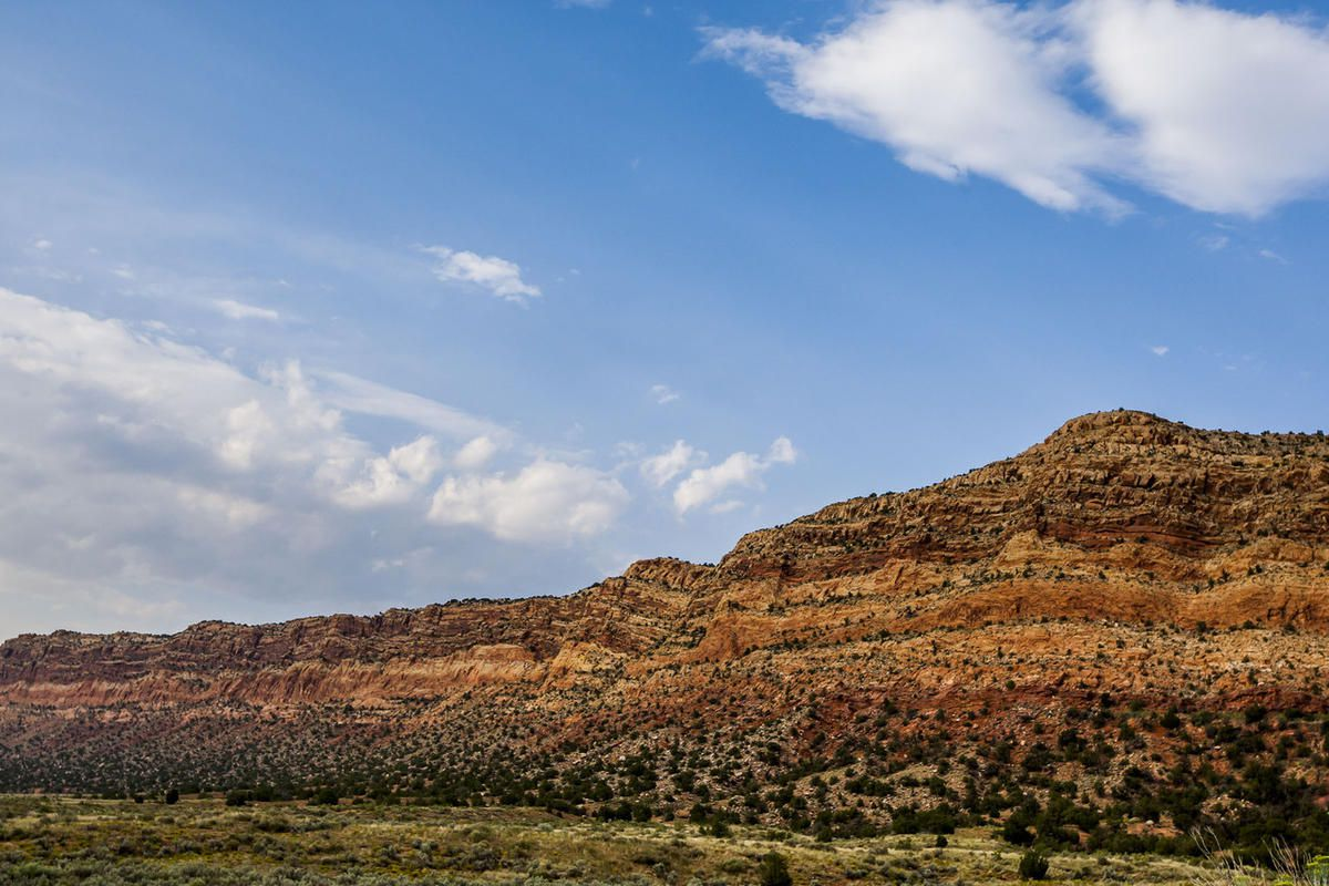 Walls of red rock line the road to Blanding on Thursday, Aug. 20, 2015. President Obama on Wednesday designated the Bears Ears area as a national monument.