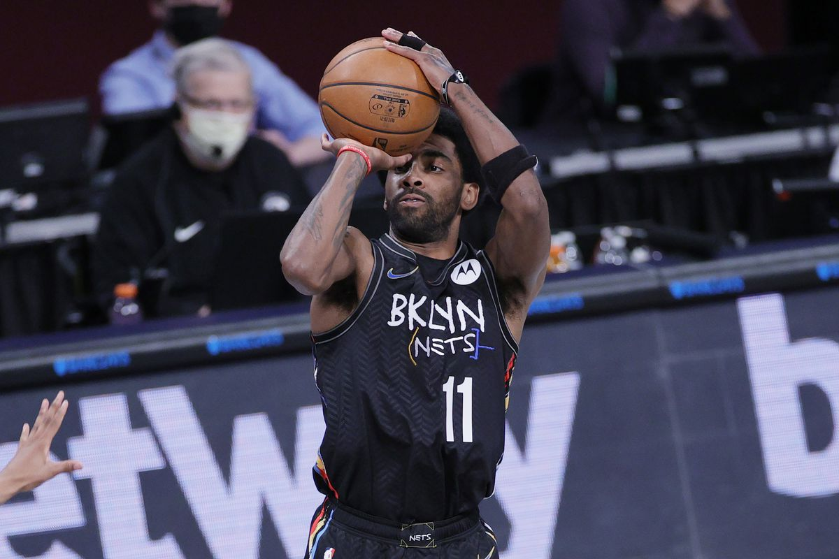Kyrie Irving #11 of the Brooklyn Nets takes a shot during the first half against the Cleveland Cavaliers at Barclays Center on May 16, 2021 in the Brooklyn borough of New York City.