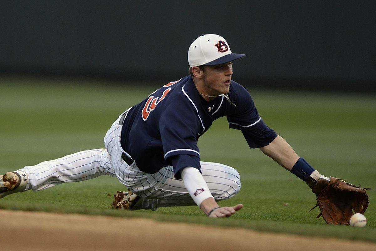 Jordan Ebert chases a ball against Ole Miss, Friday, May 3, 2013, in Auburn.