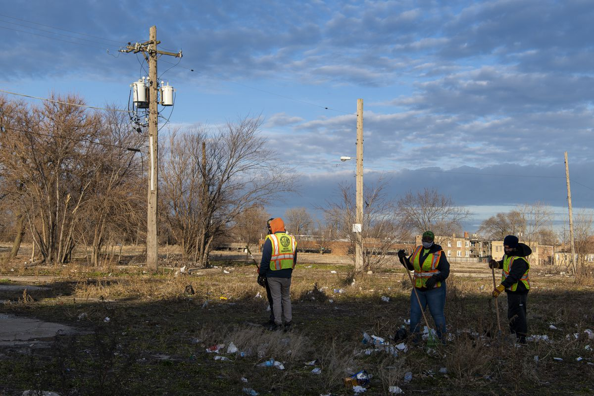 Streets and Sanitation workers clear trash from the 4300 block of West Roosevelt Road in December. The city has solicited developer interest in the property.