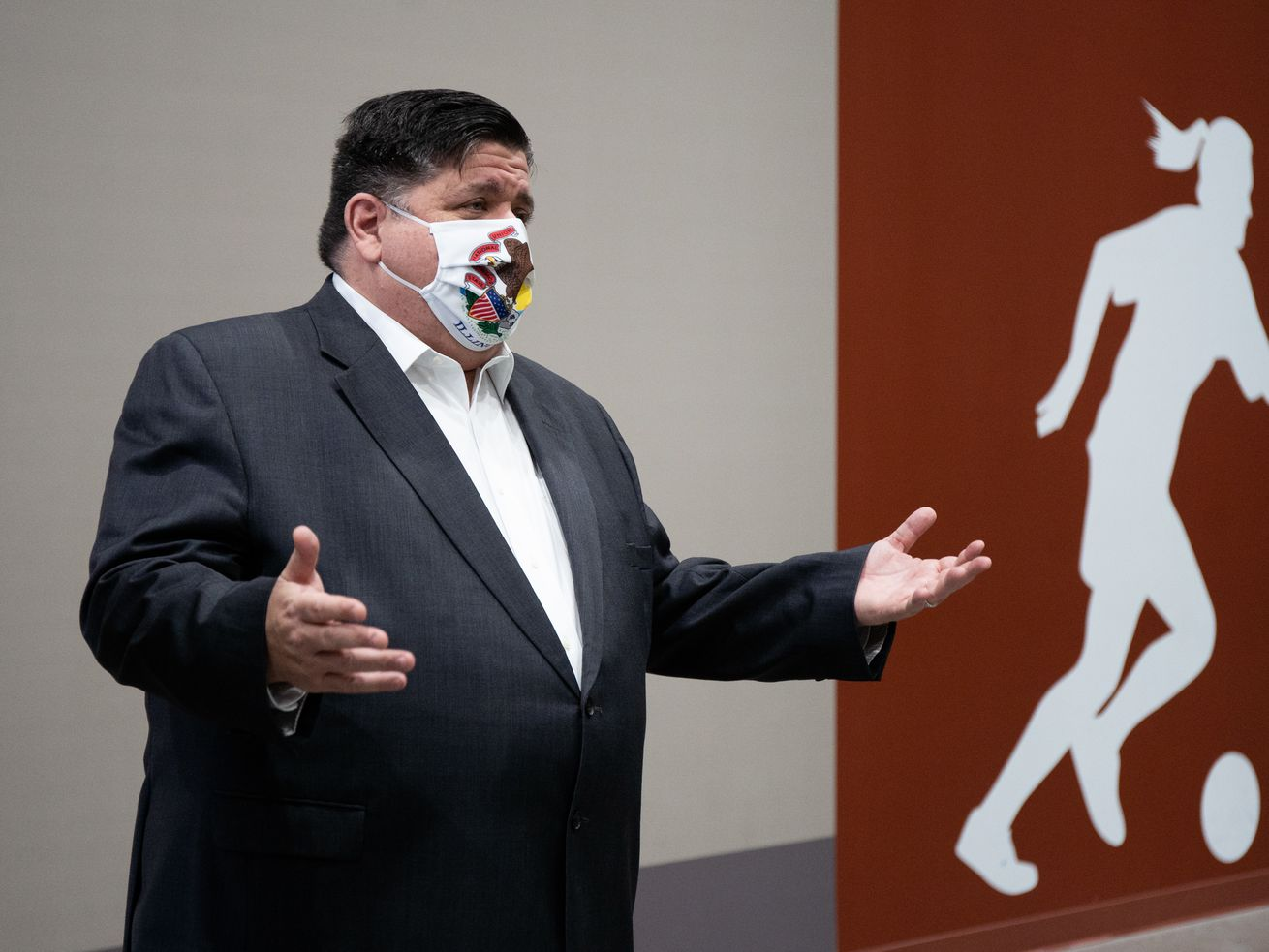 Gov. J.B. Pritzker speaks during a tour of the Pullman Community Center, which received a Business Interruption Grant, in the Pullman neighborhood on Wednesday.