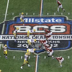 """FILE - In this Jan. 9, 2012, file photo, Alabama, right, prepares to snap the ball against LSU during the first half of the BCS National Championship college football game in New Orleans. College football has taken a big step toward having a final four. BCS Executive Director Bill Hancock said, Thursday, April, 26, 2012, that conference commissioners will present a """"small number"""" of options for a four-team playoff to their leagues."""