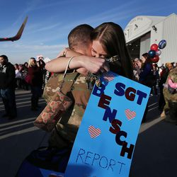 Sgt. David Bensch hugs his wife, Cynthia, as soldiers from Detachment 2, 101st Airborne Division (Air Assault) return to Utah on Friday, Nov. 18, 2016, following an 11-month deployment to Iraq.
