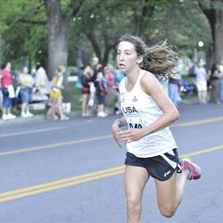 MacKenzie Chojnacky runs the Deseret News 10K race that started in Research Park and ended in Liberty Park in Salt Lake City Saturday.