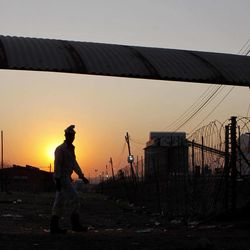 A miner from the Lonmin Platinum mine returns to work after Lonmin resolved a five-week strike by agreeing to pay raises of up to 22 percent, in Marikana, Rustenburg, South Africa, Thursday, Sept. 20, 2012.