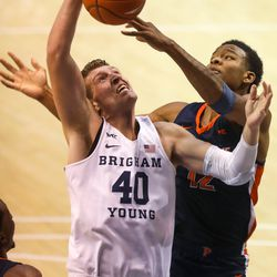 Brigham Young Cougars forward Kolby Lee (40) and Pepperdine Waves forward Kendall Munson (12) fight for the ball at the Marriott Center in Provo on Saturday, Jan. 23, 2021.