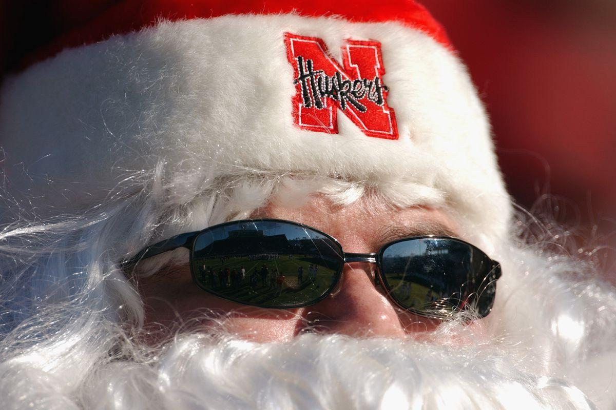 Husker fans in Santa outfit