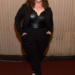 Melissa McCarthy accepts the award for Comedic Genius in an all-black ensemble.