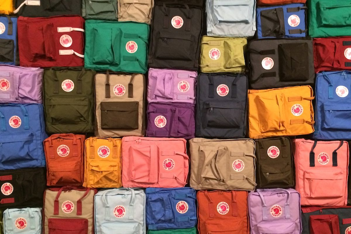 A wall of various sized Kånken backpacks