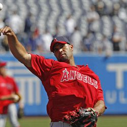 Los Angeles Angels first baseman Albert Pujols tosses a ball on the field before the Angels faced the New York Yankees in a baseball game at Yankee Stadium in New York, Friday, April 13, 2012.