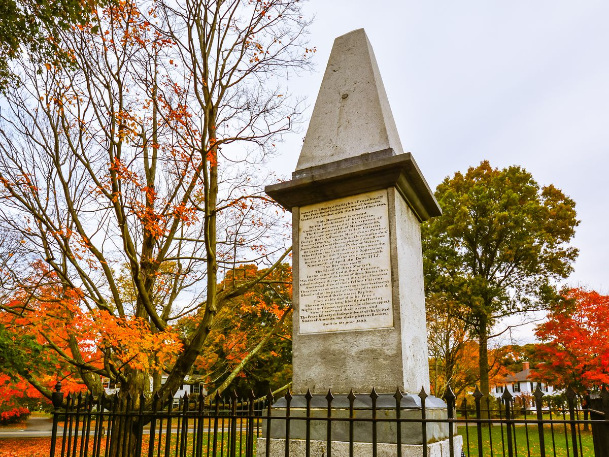 A small obelisk with writing on the front.