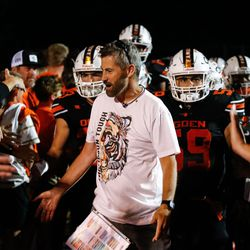 """Ogden football coach Erik Thompson, who was recently diagnosed with Lou Gehrig's disease, celebrates with his supporters during a high school football game billed as """"Erik Thompson Night"""" on Friday, Sept. 3, 2021, at Ogden High School in Ogden."""