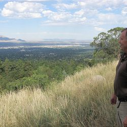 """Mental health advocate Owen Ashton, author of """"Rising Above Fog,"""" enjoys a clear view of the Salt Lake Valley."""