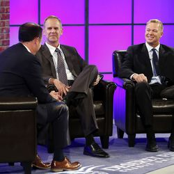 Dave McCann, left, interviews BYU Athletic Director Tom Holmoe and BYU Head Coach Bronco Mendenhall during BYU Football Media Day in Provo, Monday, June 23, 2014.