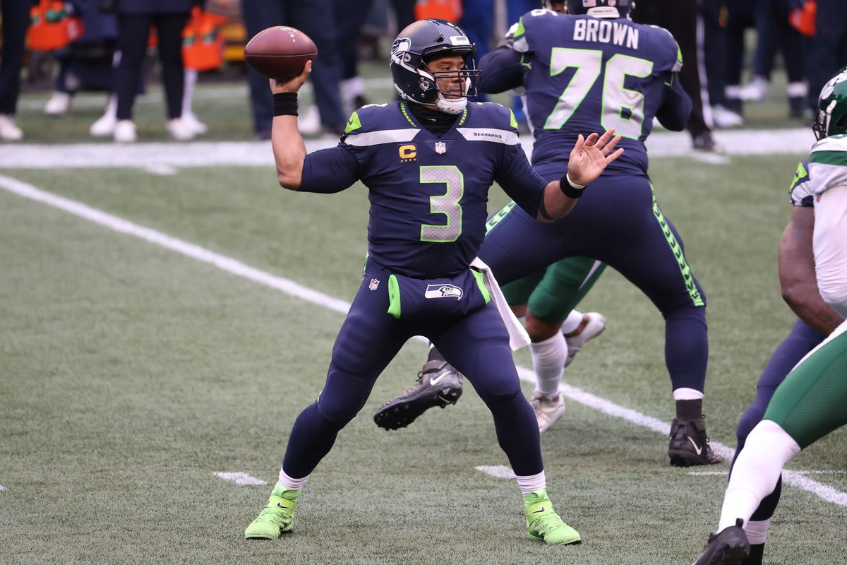 Russell Wilson #3 of the Seattle Seahawks looks to throw the ball in the first quarter against the New York Jets at CenturyLink Field on December 13, 2020 in Seattle, Washington.
