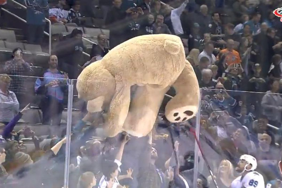 San Jose Barracuda forward Barclay Goodrow helps Barracuda fans roll a giant Teddy Bear over the boards after Goodrow scored the Barracuda's first goal of the game. (AHL Live)