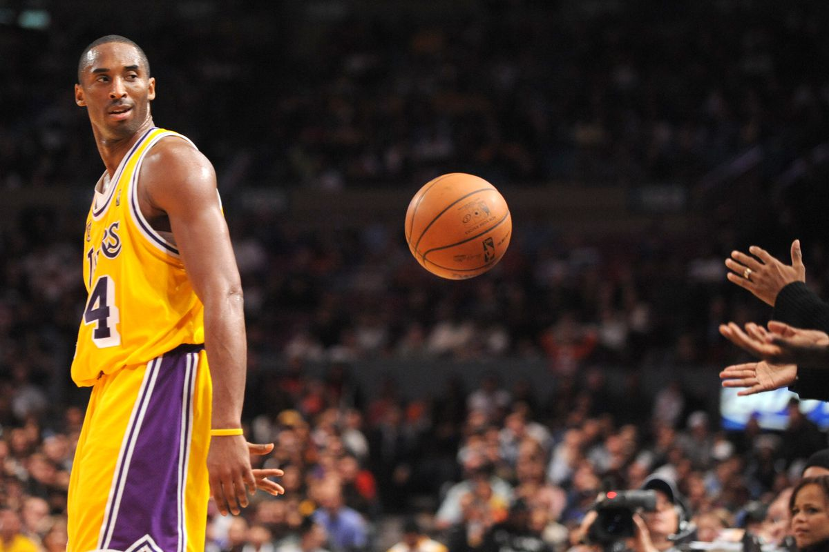 Kobe Bryant Flips a Basketball Toward Spike Lee during a New York Knicks game at Madison Square Garden in 2007