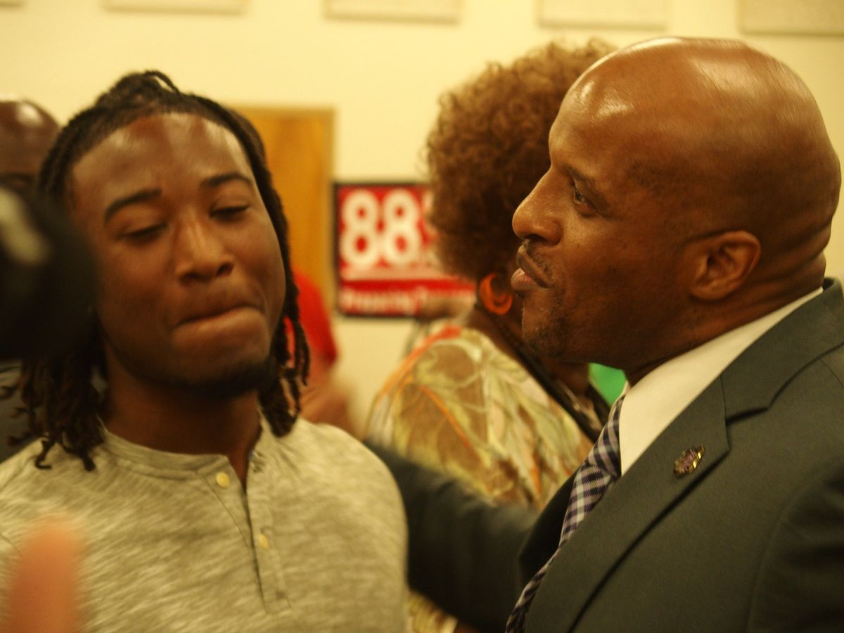 Former Trezevant High School football coach Teli White, right, and a former student who showed up to his hearing in front of the school board on June 6, 2018.