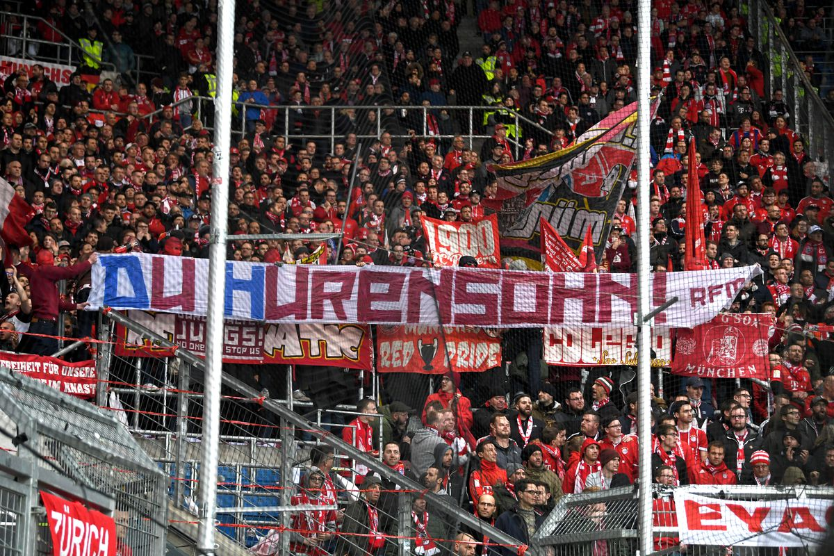 """Bayern Munich fans displaying a sign saying """"you son of a whore"""""""
