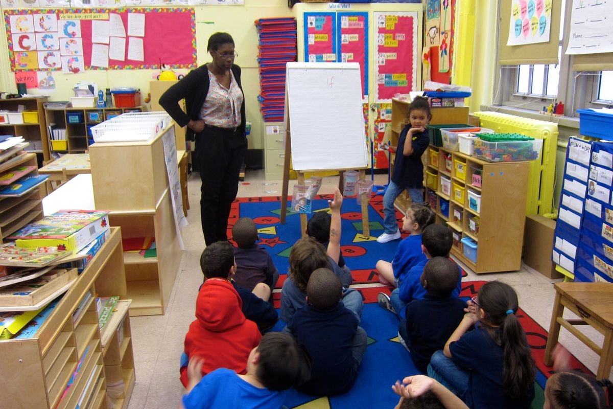 """Judith Colon, left, asks her pre-K students at P.S. 63 to use the word """"if"""" in a sentence."""