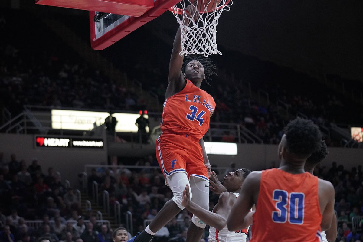 East St. Louis senior Terrence Hargrove (34) gets a huge dunk in the second half of the Class 3A state championship game.