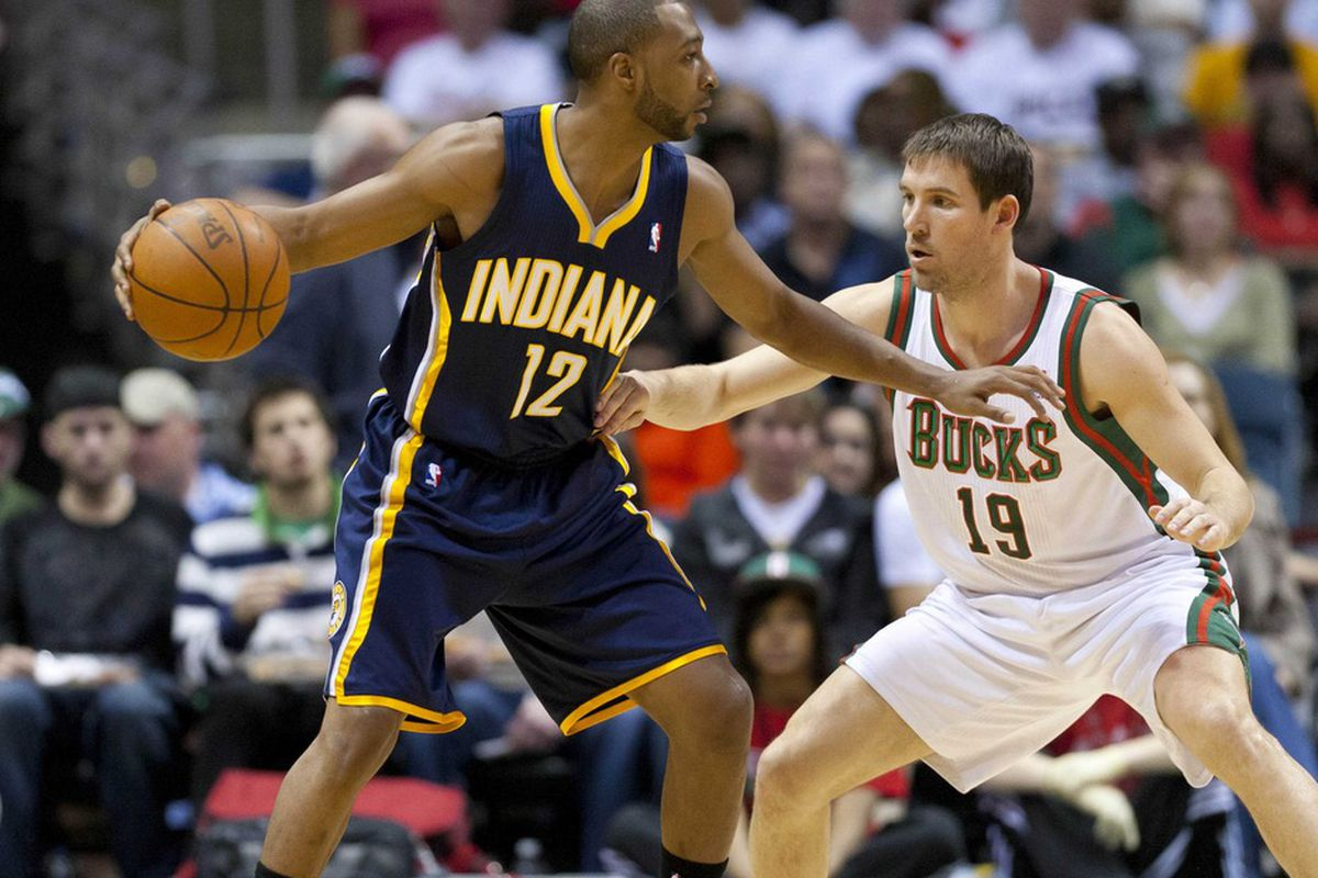 Apr 14, 2012; Milwaukee, WI, USA;  Indiana Pacers guard A.J. Price (12) during the game against the Milwaukee Bucks at the Bradley Center.  The Pacers defeated the Bucks 105-99.  Mandatory Credit: Jeff Hanisch-US PRESSWIRE