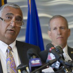 Salt Lake County District Attorney Sim Gill speaks during a press conference at the FBI's Salt Lake City Division office about the arrests of former Utah Attorneys General Mark Shurtleff and John Swallow, Tuesday, July 15, 2014.