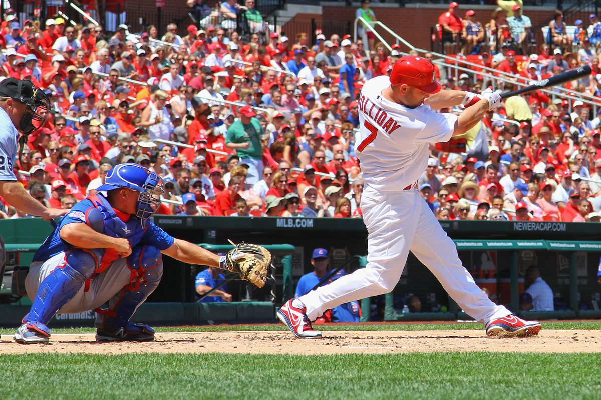 ST. LOUIS, MO - JULY 22: Matt Holliday #7 of the St. Louis Cardinals hits a double against the Chicago Cubs at Busch Stadium on July 22, 2012 in St. Louis, Missouri.  (Photo by Dilip Vishwanat/Getty Images)