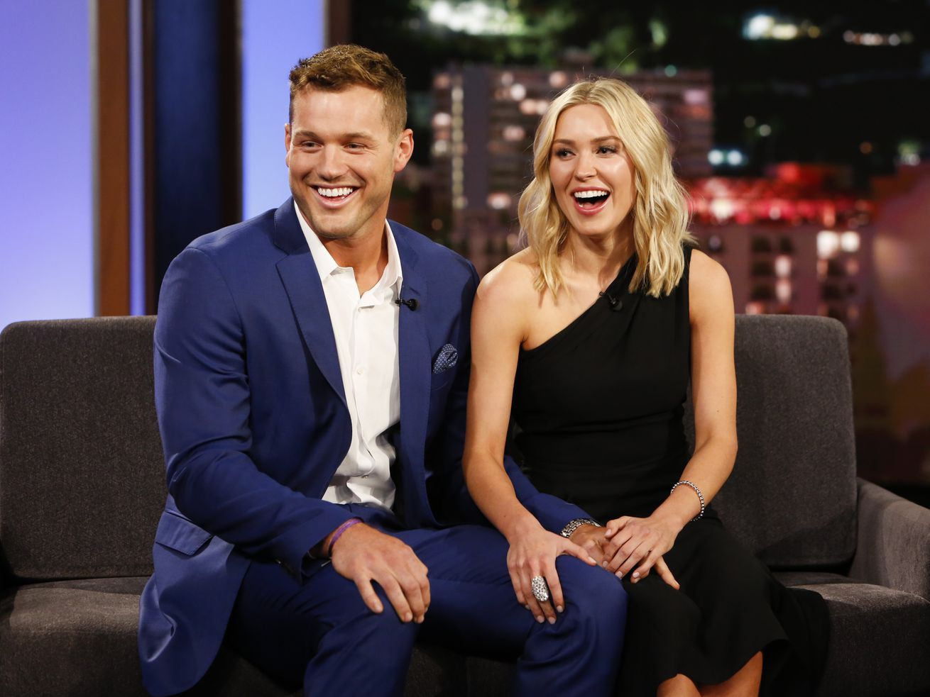 Colton Underwood and Cassie Underwood sitting together on a television stage.