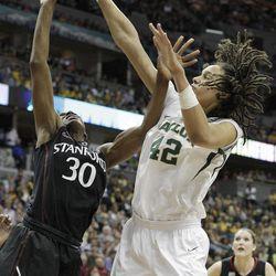 Baylor center Brittney Griner (42) blocks Stanford forward Nnemkadi Ogwumike (30) shot during the second half of an NCAA women's Final Four semifinal college basketball game, in Denver, Sunday, April 1, 2012.