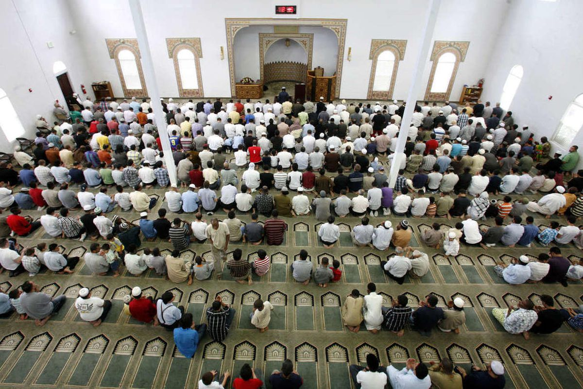 Men pray at the Khadeeja Islamic Center in West Valley City on Friday, June 29, 2012.