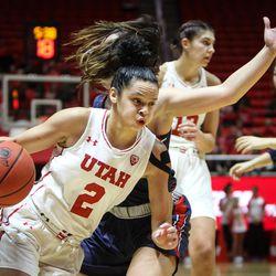 Utah Utes guard Tori Williams (2) drives past the defense of Saint Mary's guard Jasmine Forcadilla (3) as Utah hosts Saint Mary's at the Huntsman Center in Salt Lake on Saturday, Dec. 2, 2017.