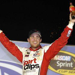 Denny Hamlin celebrates in Victory Lane after winning the NASCAR Sprint Cup Series auto race at Atlanta Motor Speedway, Sunday, Sept. 2, 2012, in Hampton, Ga.