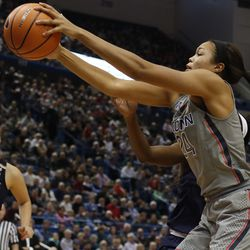 UConn's Napheesa Collier (24) fights for a rebound during the Notre Dame Fighting Irish vs UConn Huskies women's college basketball game in the Women's Jimmy V Classic at the XL Center in Hartford, CT on December 3, 2017.
