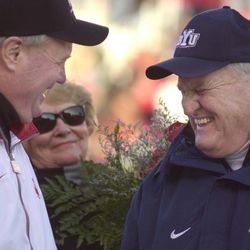 Utah football coach Ron McBride, left, and BYU football coach LaVell Edwards greet each other before the game at Rice Eccles Stadium at the University of Utah on Friday, Nov. 24, 2000.