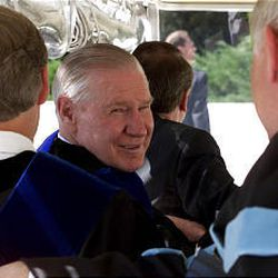 President James E. Faust talks with others in the cart that took him to the Marriott Center for BYU graduation ceremonies.