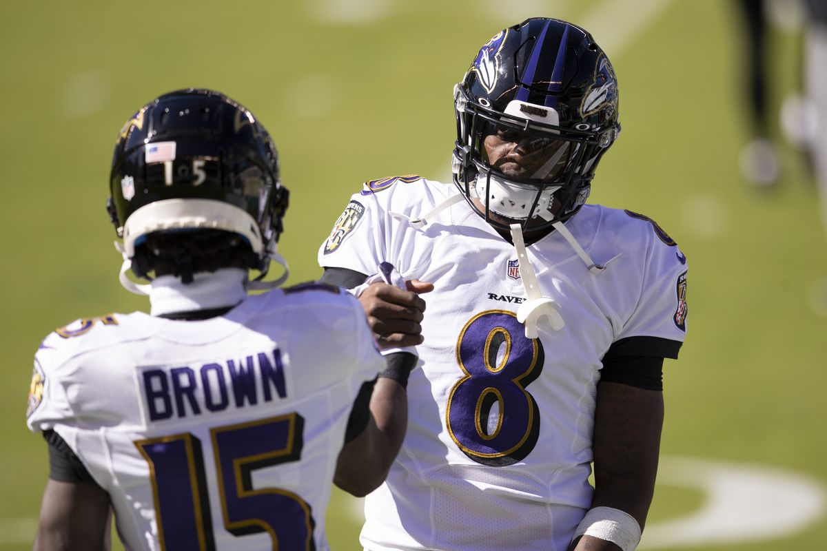 Marquise Brown #15 and Lamar Jackson #8 of the Baltimore Ravens embrace prior to the game against the Philadelphia Eagles at Lincoln Financial Field on October 18, 2020 in Philadelphia, Pennsylvania.