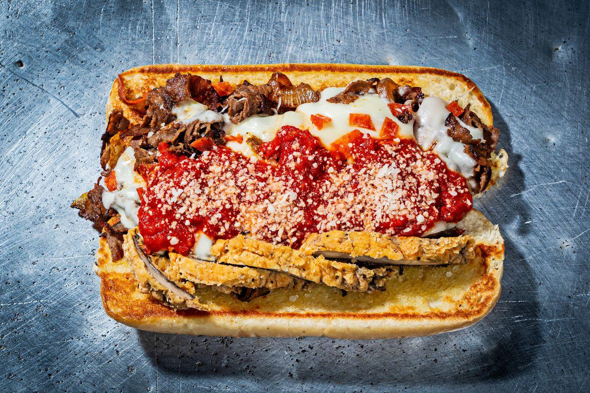 A pizza steak has fried mushrooms, pepperoni, and marinara sauce