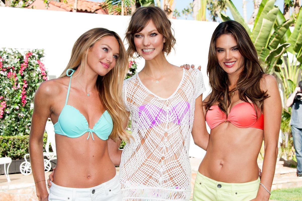 Three Victoria's Secret models in bikinis.