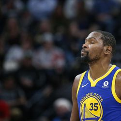 Golden State Warriors forward Kevin Durant walks down the court as the Warriors trail the Utah Jazz in the first half at Vivint Arena in Salt Lake City on Tuesday, April 10, 2018.