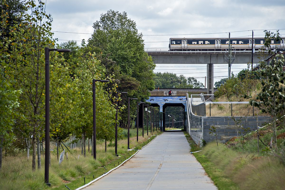 A downtown-bound MARTA train passes over the Beltline's West Trail at the Lee Street tunnel.