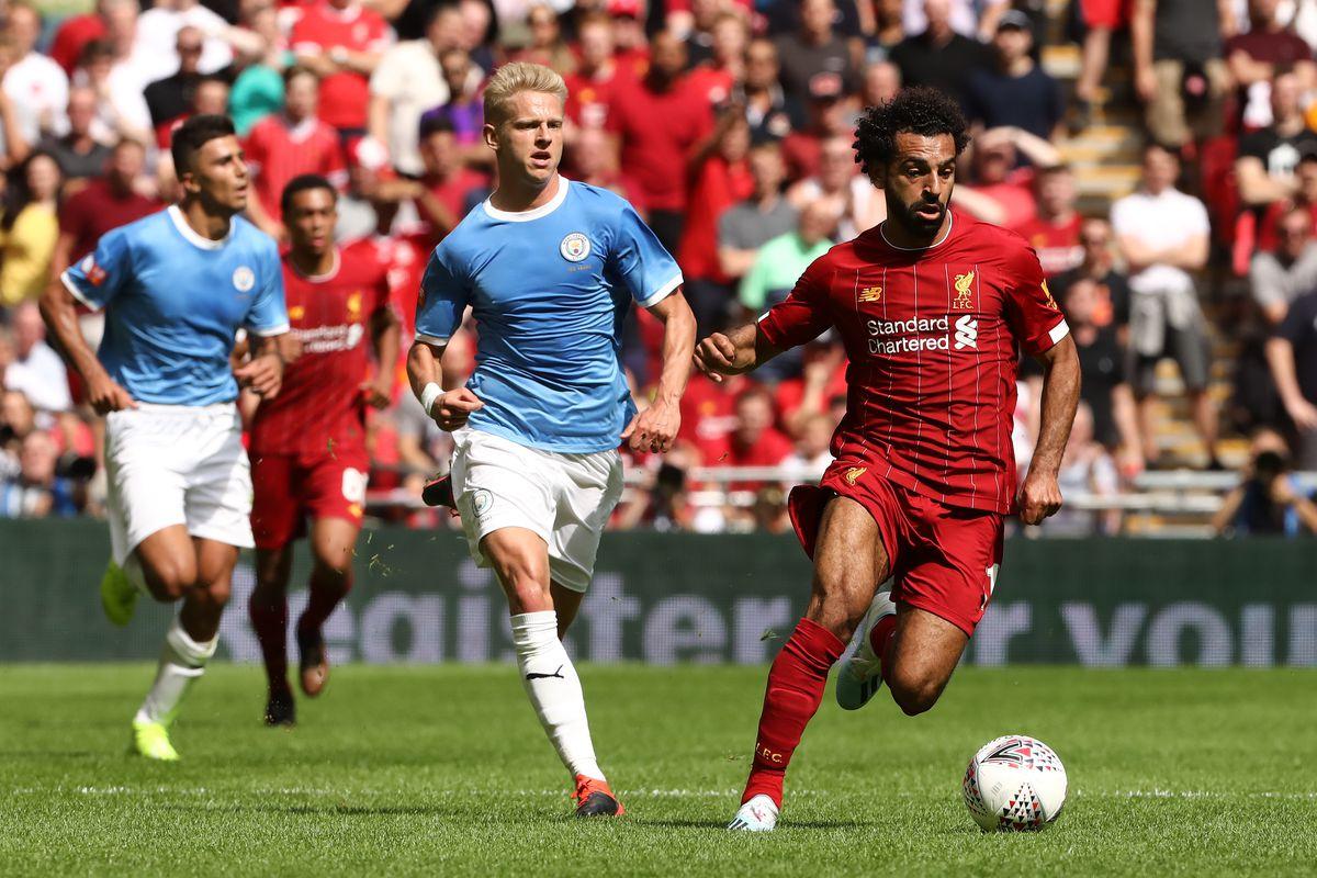 Mohamed Salah of Liverpool and Oleksandr Zinchenko of...