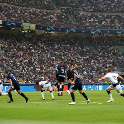 Christian Eriksen of Tottenham Hotspur shoots from a free kick during the Group B match of the UEFA Champions League between FC Internazionale and Tottenham Hotspur at San Siro Stadium on September 18, 2018 in Milan, Italy.