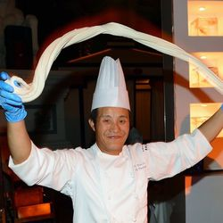 Chef Jin-Yaun Li prepares hand-stretched noodles at the Beijing Noodle Co. booth at Vegas Uncork'd by Bon Appetit's Grand Tasting. Photo: Ethan Miller/Getty Images