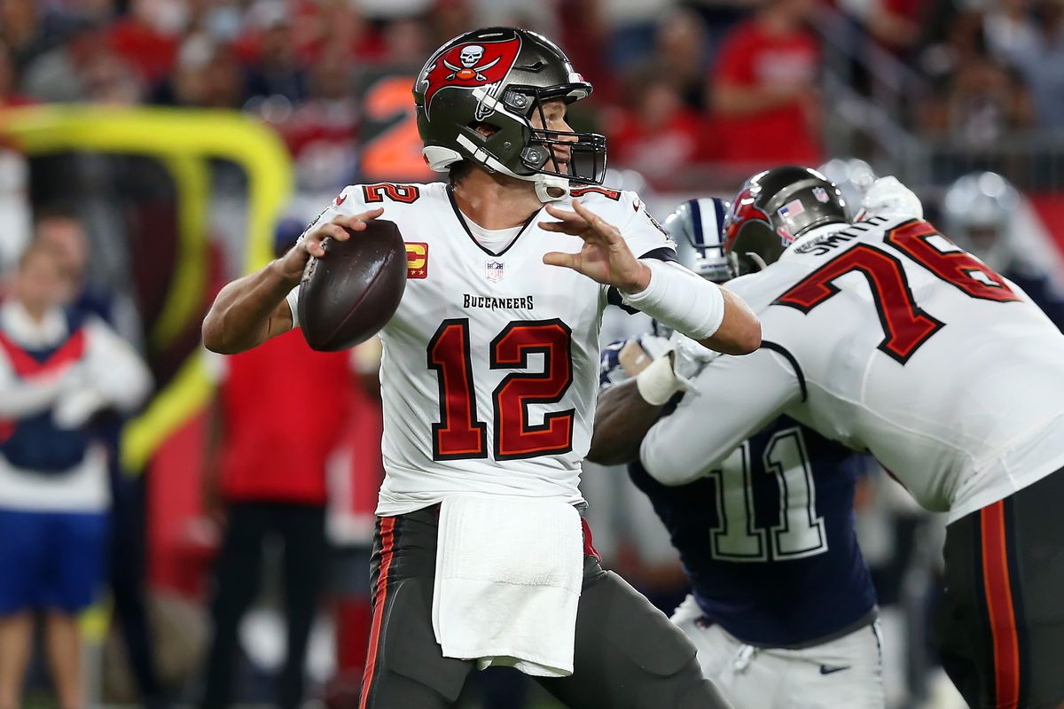 Tampa Bay Buccaneers Quarterback Tom Brady (12) looks for an open receiver during the regular season game between the Dallas Cowboys and the Tampa Bay Buccaneers on September 09, 2021 at Raymond James Stadium in Tampa, Florida.