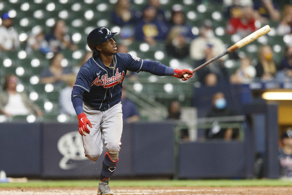 Atlanta Braves second baseman Ozzie Albies (1) hits a solo home run during the fifth inning against the Milwaukee Brewers at American Family Field.